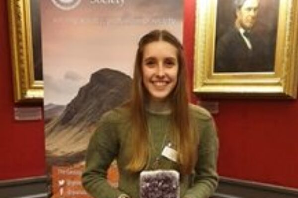 Charlotte Copley posing with her award